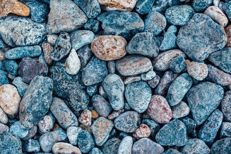 多彩多姿的海石头,海滩小卵石背景,纹理 免版税库存图片