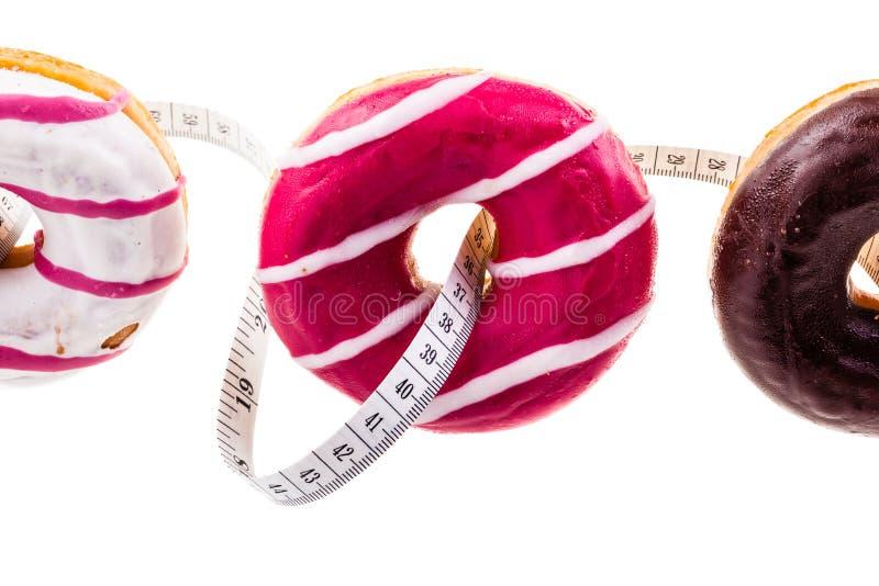 多福饼和测量的磁带 免版税图库摄影