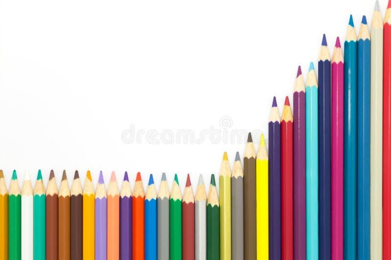 多色在白色背景的木铅笔 免版税图库摄影