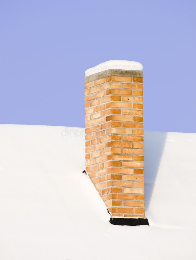 多雪的烟囱 库存图片