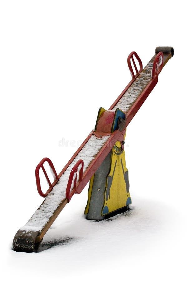 多雪的跷跷板 免版税图库摄影