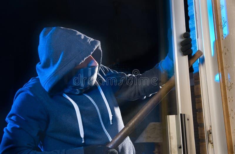 夜贼在工作 库存图片