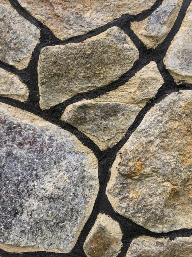 大冰砾老石墙纹理  免版税库存照片