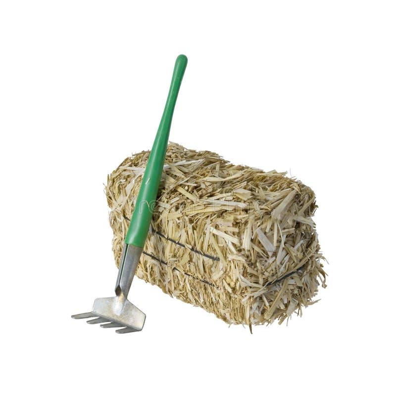 大包与犁耙的干草 图库摄影