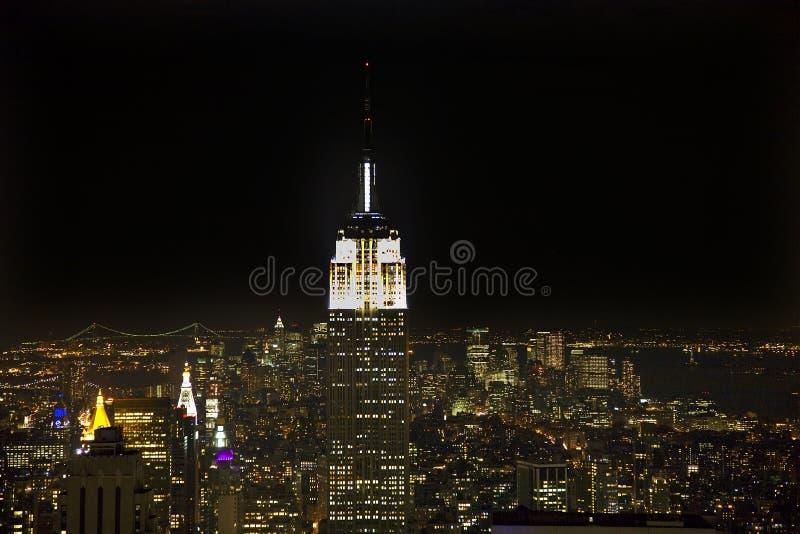 大厦城市帝国新的晚上地平线状态约&# 库存照片