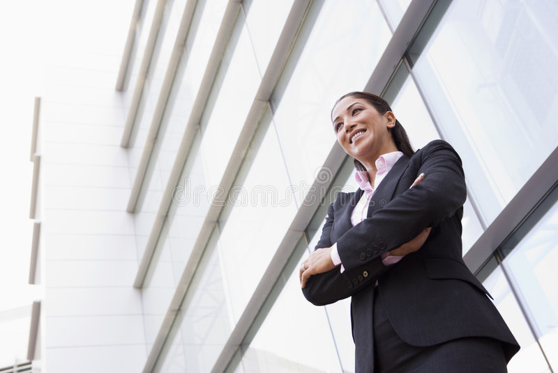 大厦女实业家办公室外部身分 免版税图库摄影