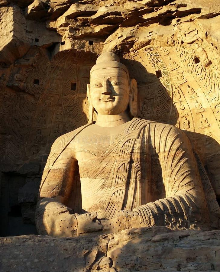 大同,山西,中国-云岗石窟的大坐的菩萨 库存照片