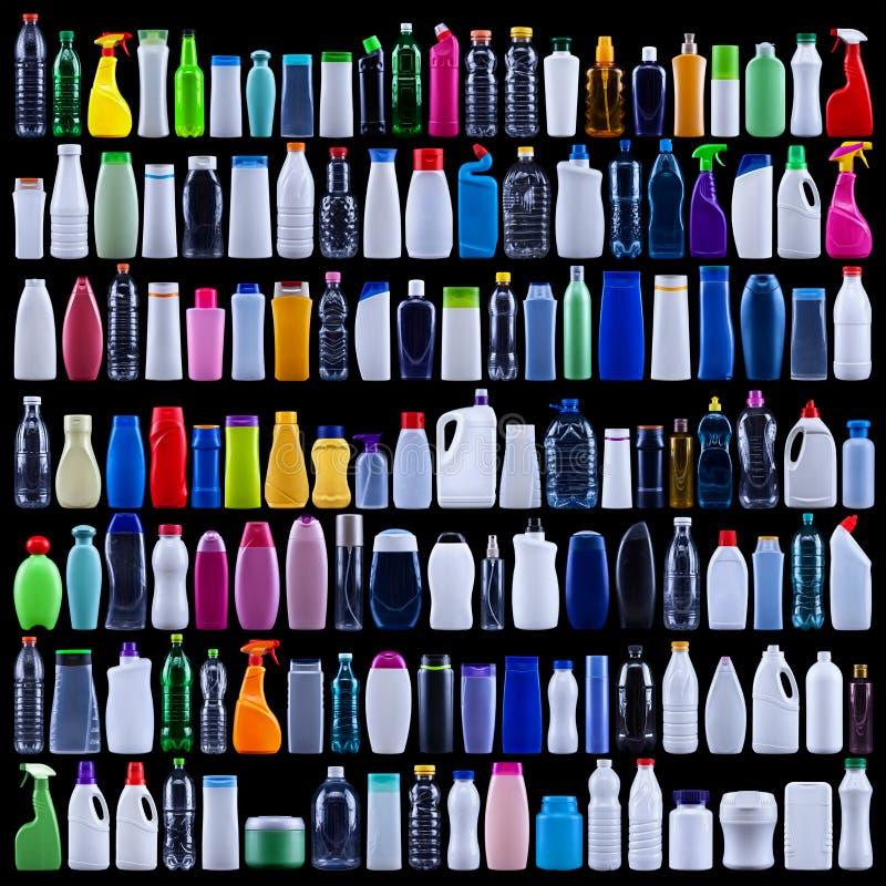 大套在黑色的塑料瓶 库存照片