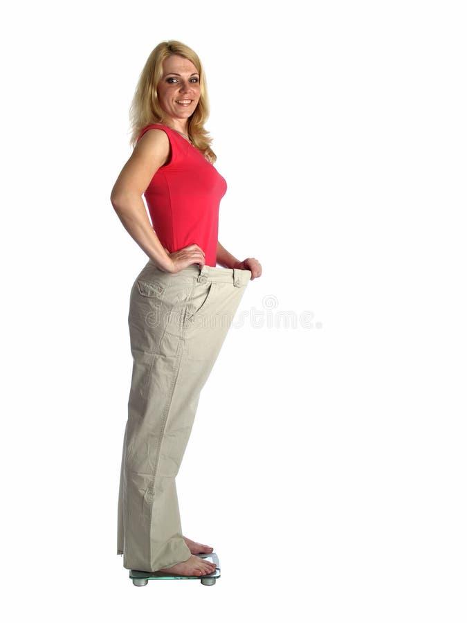 大女孩裤子缩放比例 库存照片