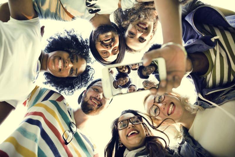 大学生配合谈的照片概念 库存图片