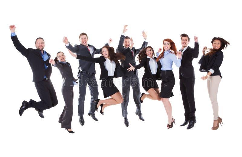 大小组激动的商人 免版税库存照片