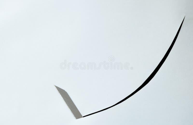 大幅度削减在白皮书背景的刀片曲线 图库摄影