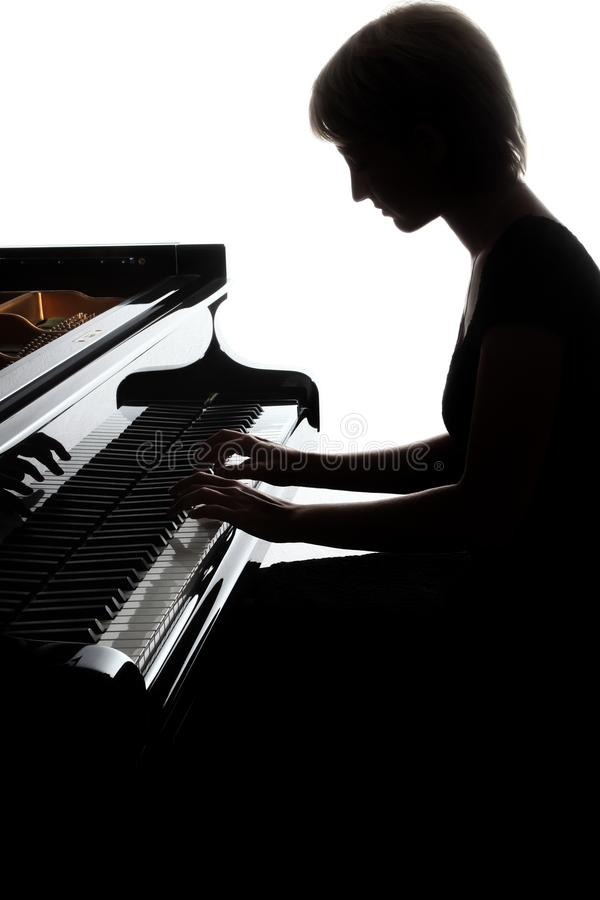 大平台钢琴球员 弹钢琴的钢琴演奏家妇女 库存照片