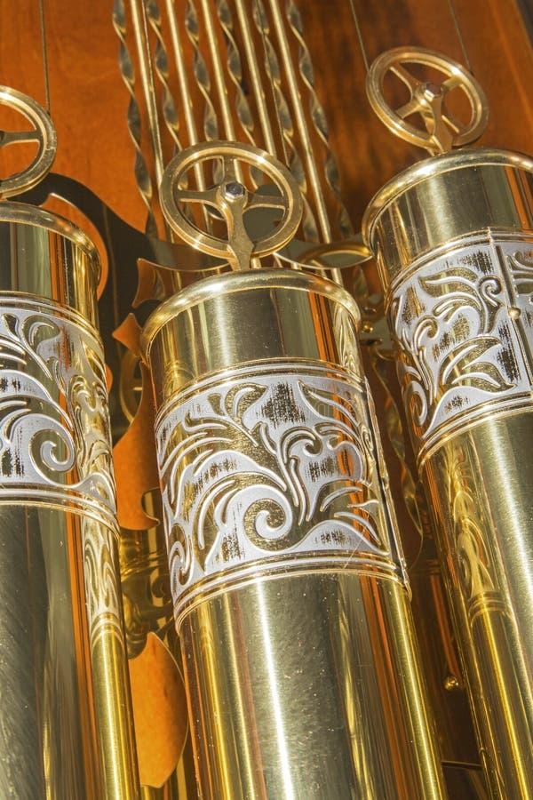 大座钟黄铜衡量被渔的滑轮 图库摄影