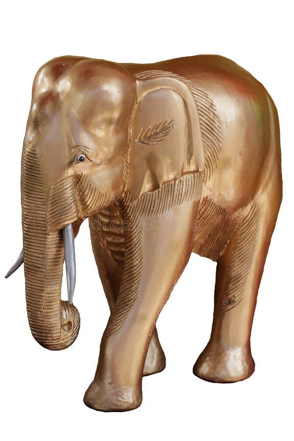大木大象用在白色背景隔绝的金子装饰,雕刻在木头,旅游业的多数有吸引力的纪念品从 库存照片