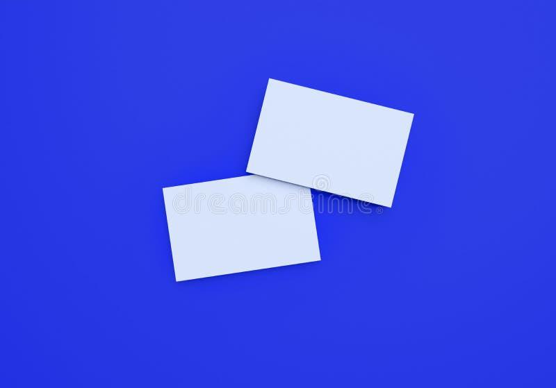 大模型在蓝色背景的名片 免版税库存图片