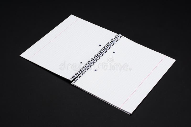 大模型杂志、书或者编目在黑桌背景 免版税图库摄影
