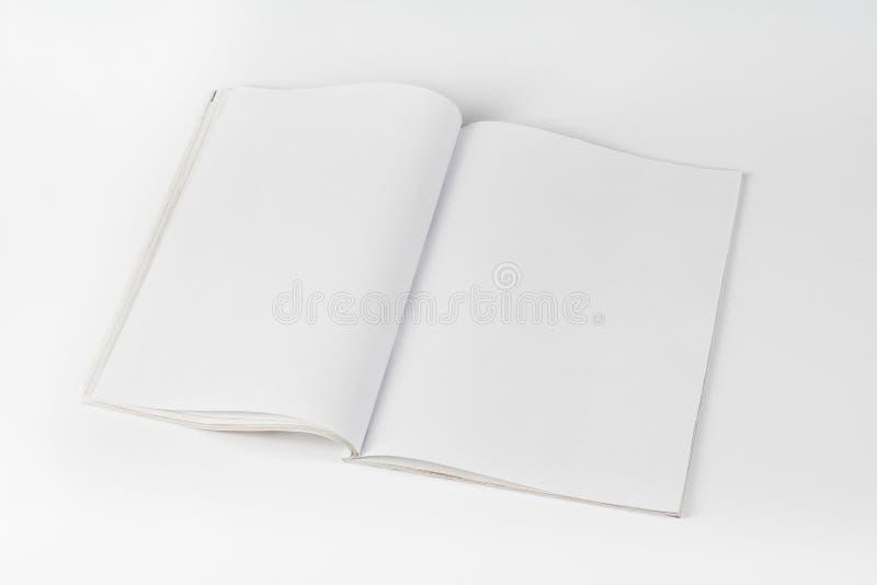 大模型杂志或编目在白色桌背景 免版税库存照片