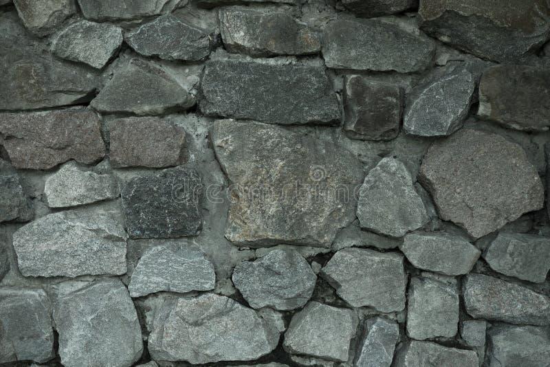 大灰色石墙纹理 库存照片