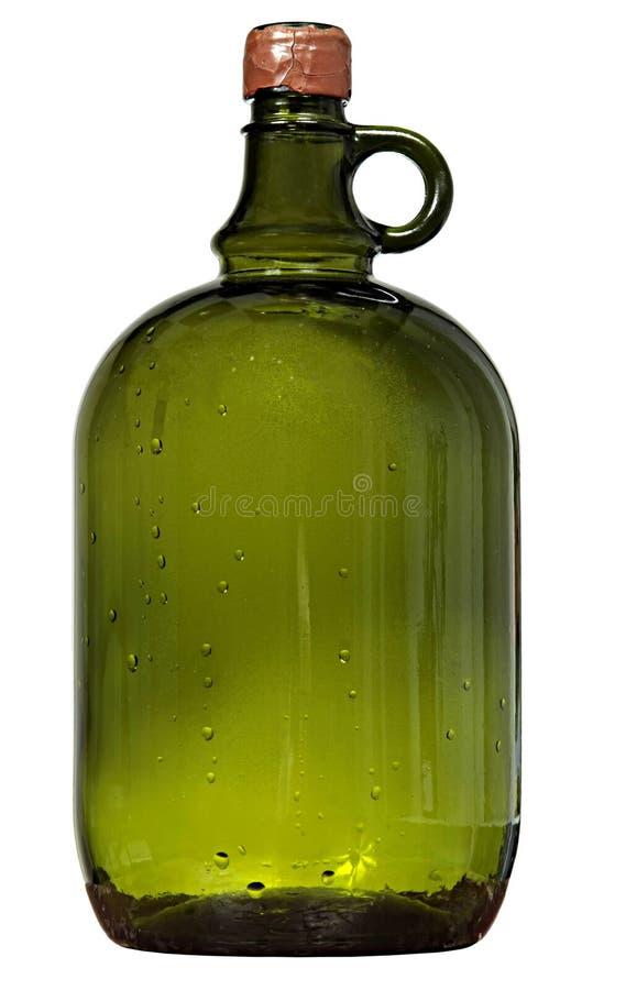 大玻璃瓶绿色酒 免版税库存图片