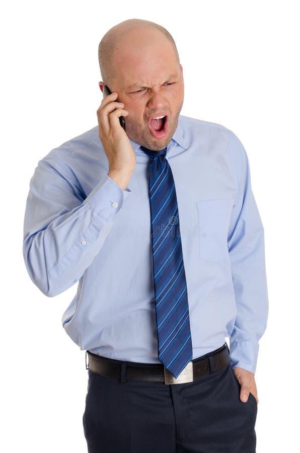 大胆的人叫喊对电话 库存照片