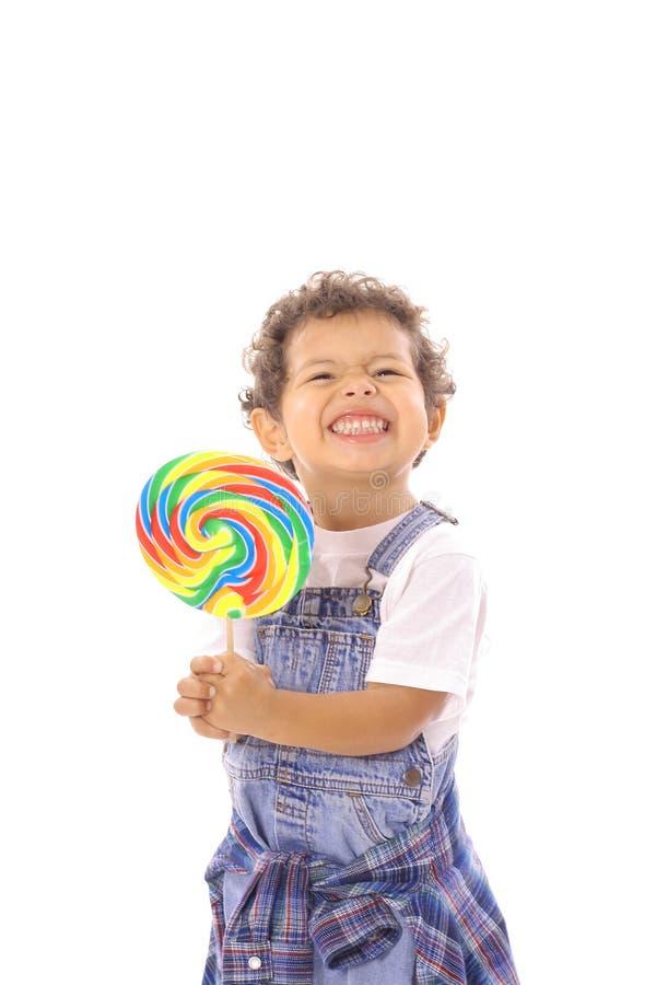 大表面滑稽的棒棒糖小孩 免版税库存照片