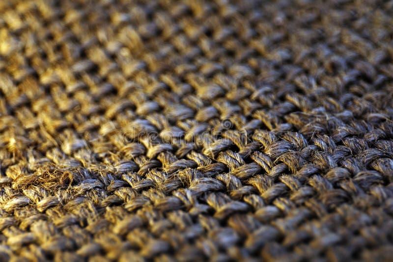 大袋纹理老为背景选择聚焦,关闭大袋棕色织地不很细表面,粗麻布被编织的表面,老粗麻布 免版税图库摄影