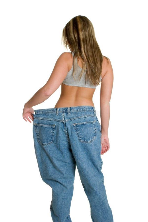 大裤子皮包骨头的妇女 库存照片