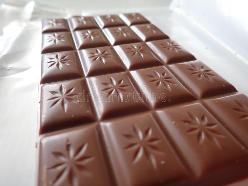 大量棕色甜巧克力 免版税库存图片