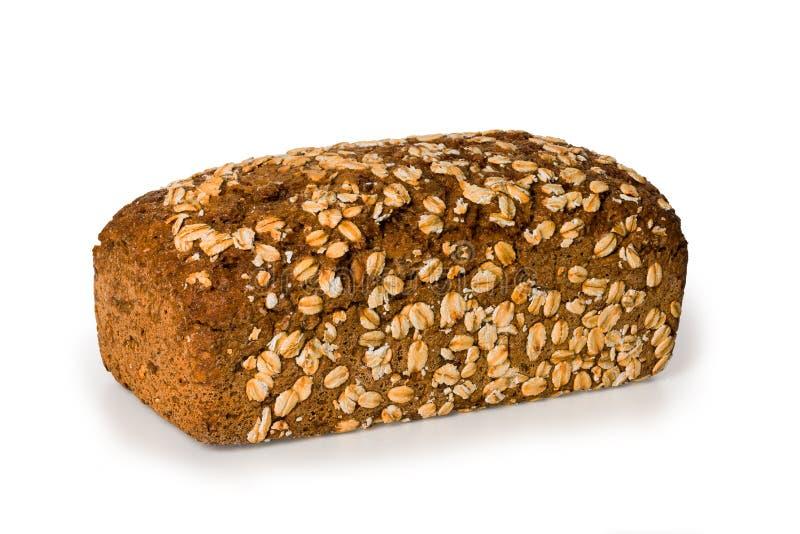 大面包整个五谷黑面包隔绝了白色背景 图库摄影
