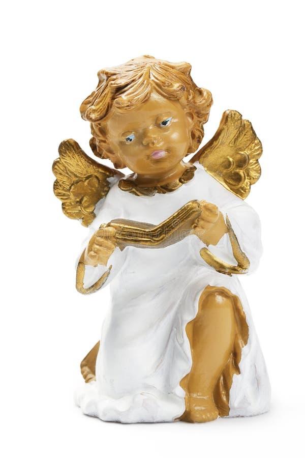 天使书圣诞节小雕象 免版税图库摄影