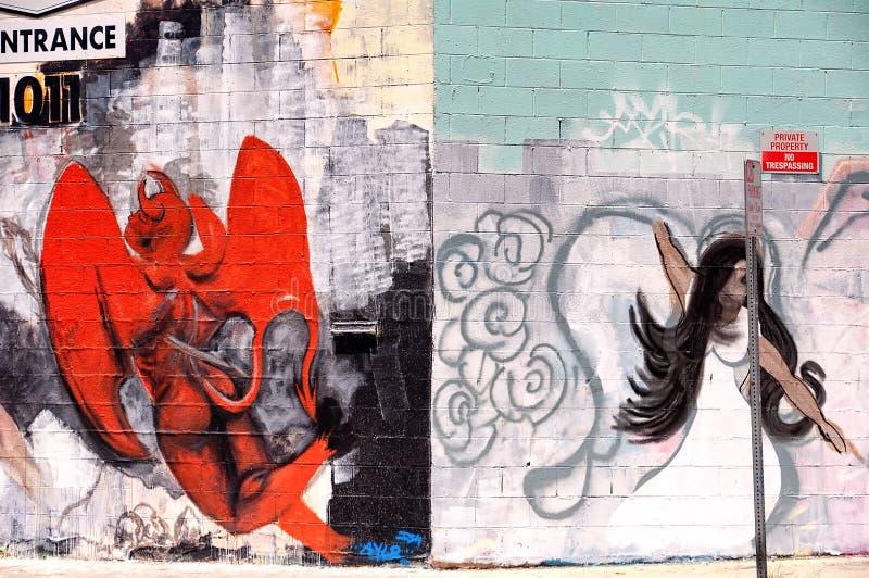 天使和恶魔街道画洛杉矶加利福尼亚 免版税库存照片