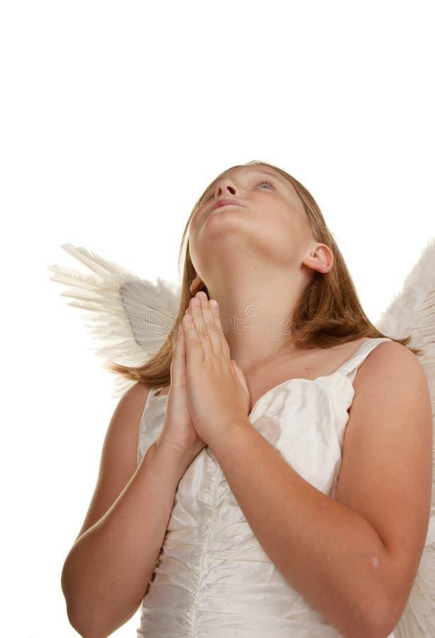 天使女孩祈祷的年轻人 免版税图库摄影