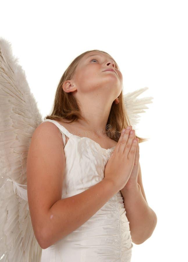 天使女孩祈祷的年轻人 免版税库存图片