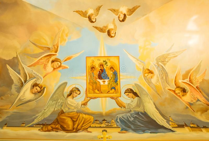 天使拿着三位一体的象 图库摄影