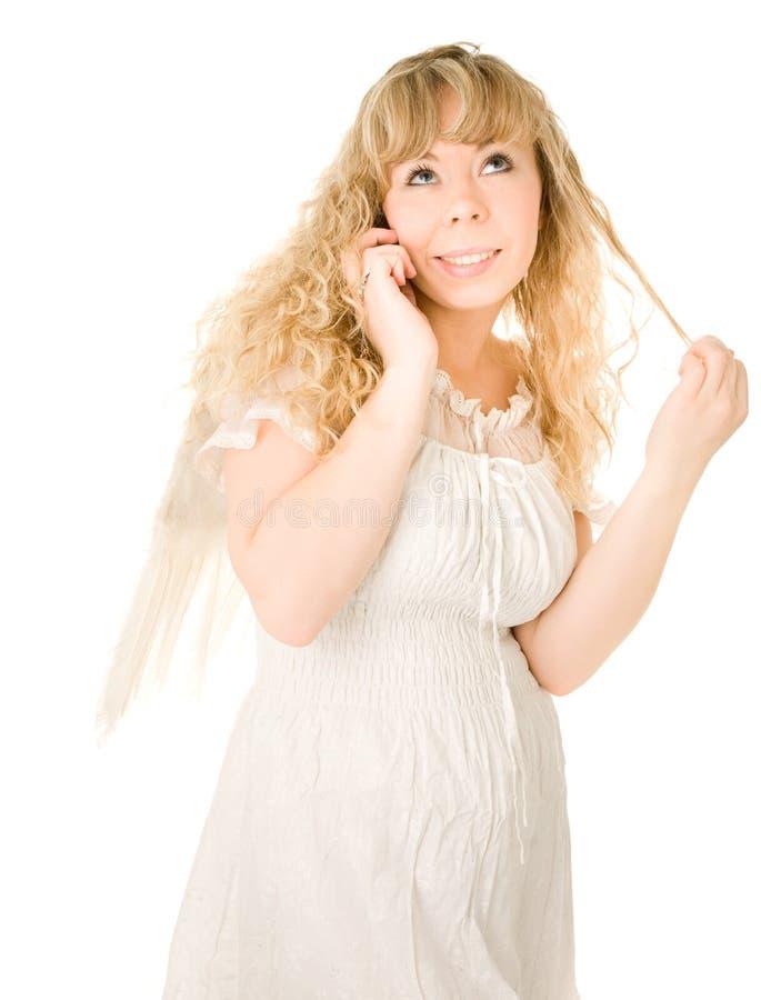 天使白肤金发的女孩电话 免版税库存图片