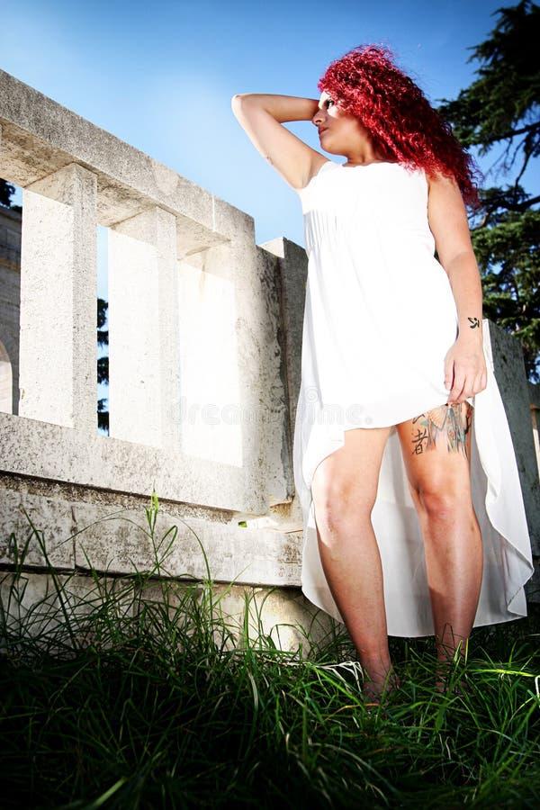 天使红色头发称呼了青少年 免版税库存图片