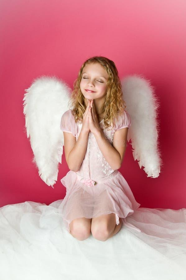 天使逗人喜爱的女孩 免版税库存照片