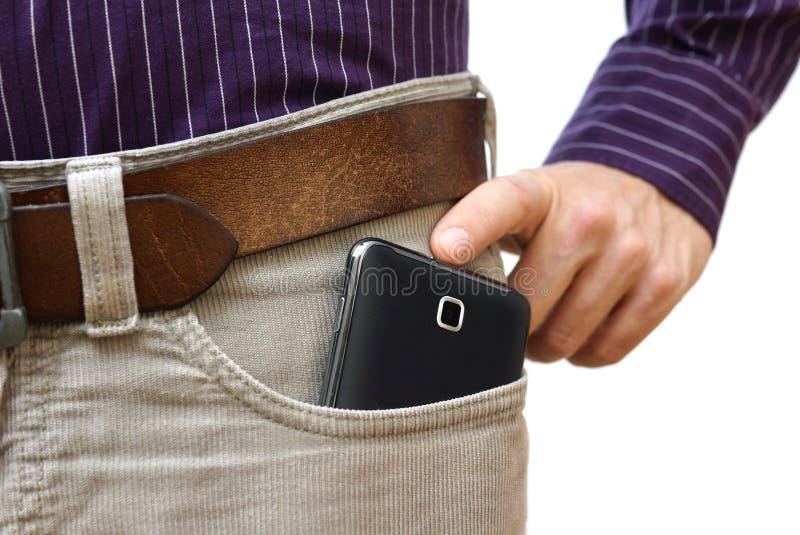 太在裤子的大手机 库存图片