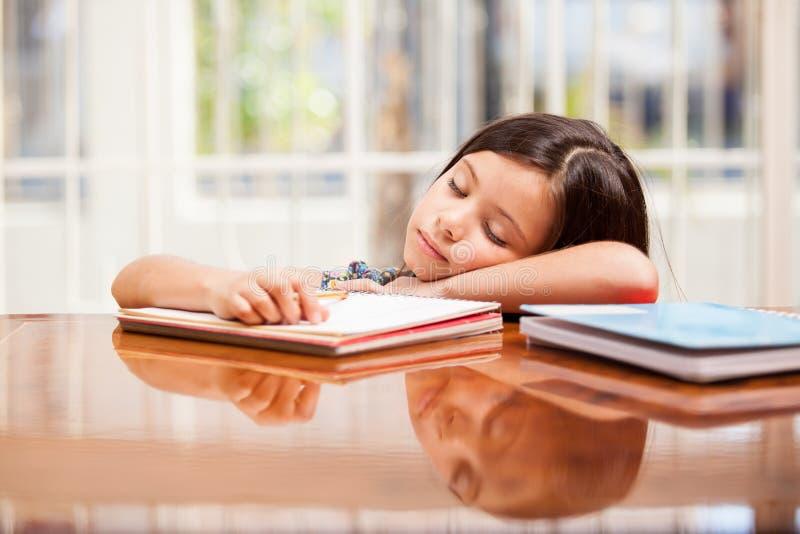太疲倦为家庭作业 免版税库存照片