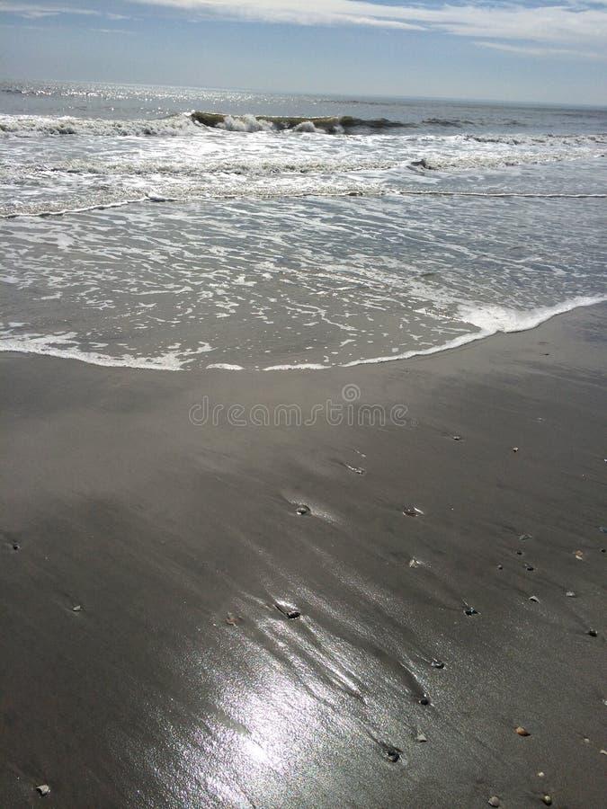 太阳、水和沙子 免版税库存照片