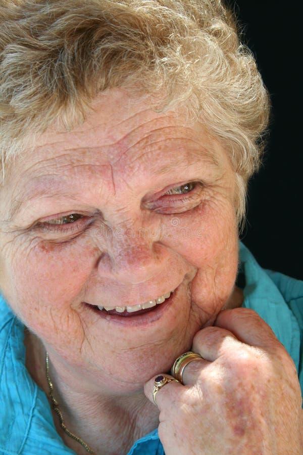 夫人笑的前辈 免版税库存照片