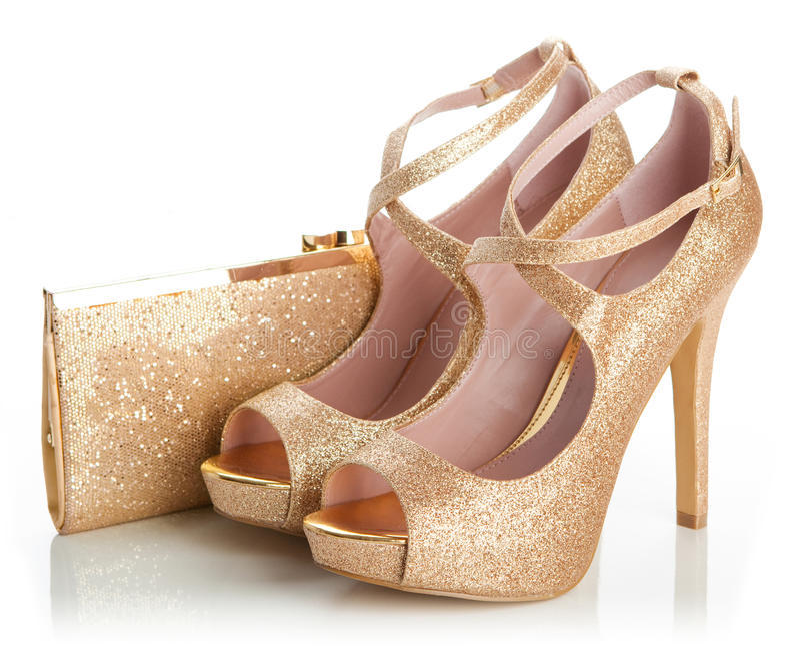 夫人金鞋子和袋子 免版税库存图片
