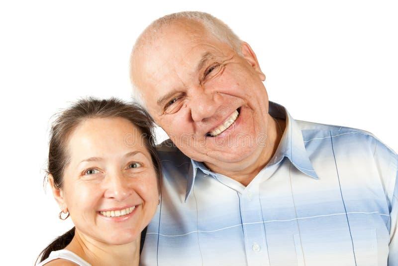 夫妇可爱的成熟保持平衡的工作室白色 免版税库存照片