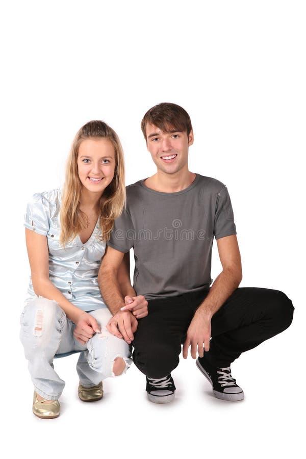 夫妇坐少年 库存图片