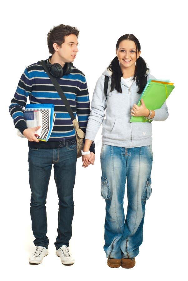 夫妇学员走 免版税库存图片