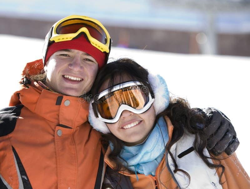 夫妇幸运山挡雪板 免版税库存照片