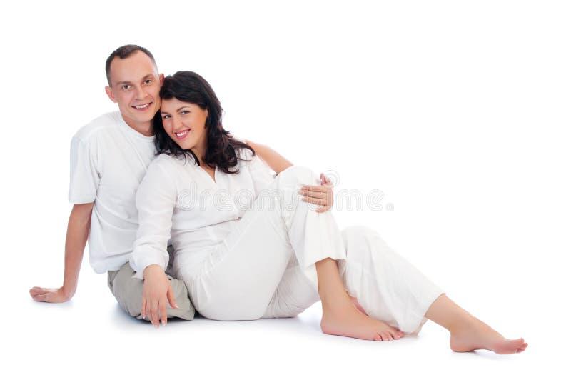 夫妇微笑的年轻人 免版税库存照片