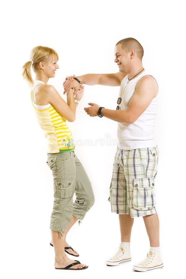 夫妇愉快的射击工作室年轻人 库存图片