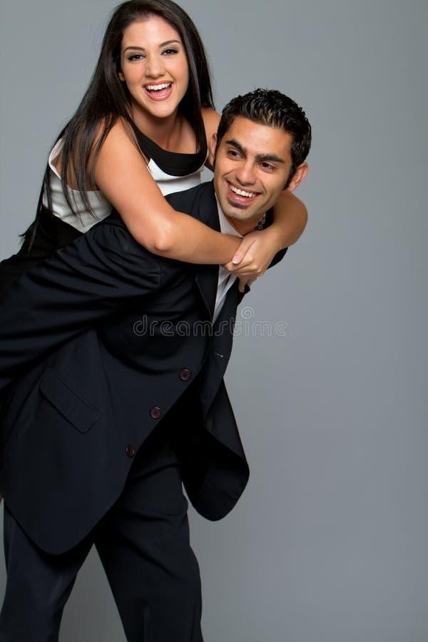夫妇愉快的微笑的年轻人 库存照片